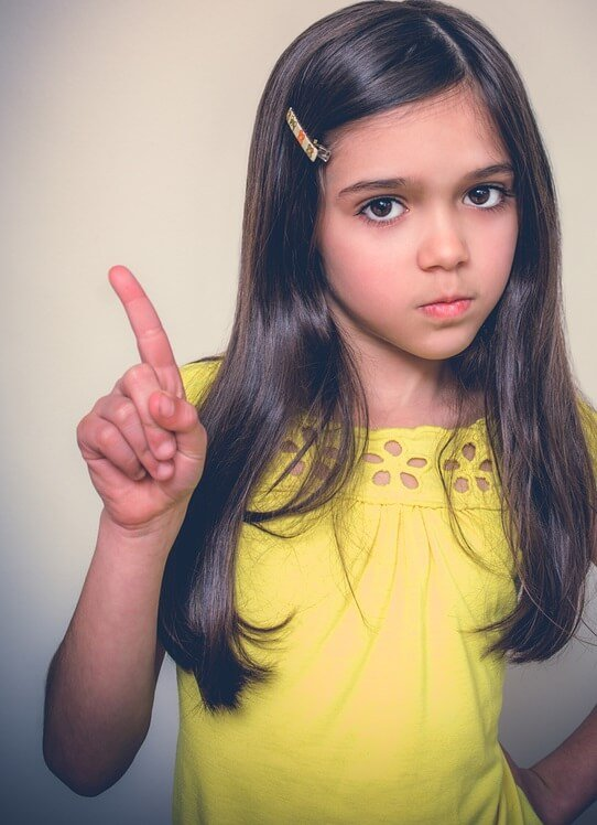 Girl wagging finger to illustrate Google's guidelines on nofollow links for bloggers