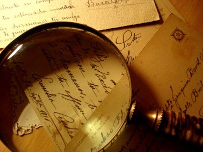 picture of magnifying glass over documents
